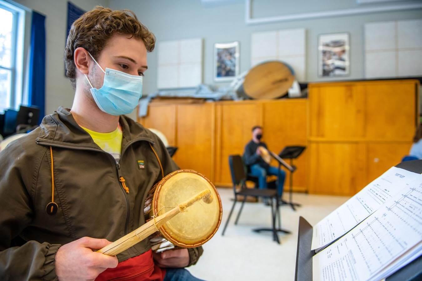MUE 321 students practice drumming.