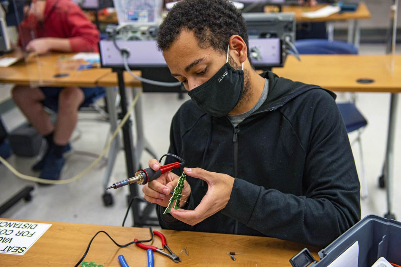 A student gets hands-on experience in Jude Pearse's electrical engineering technology lab.