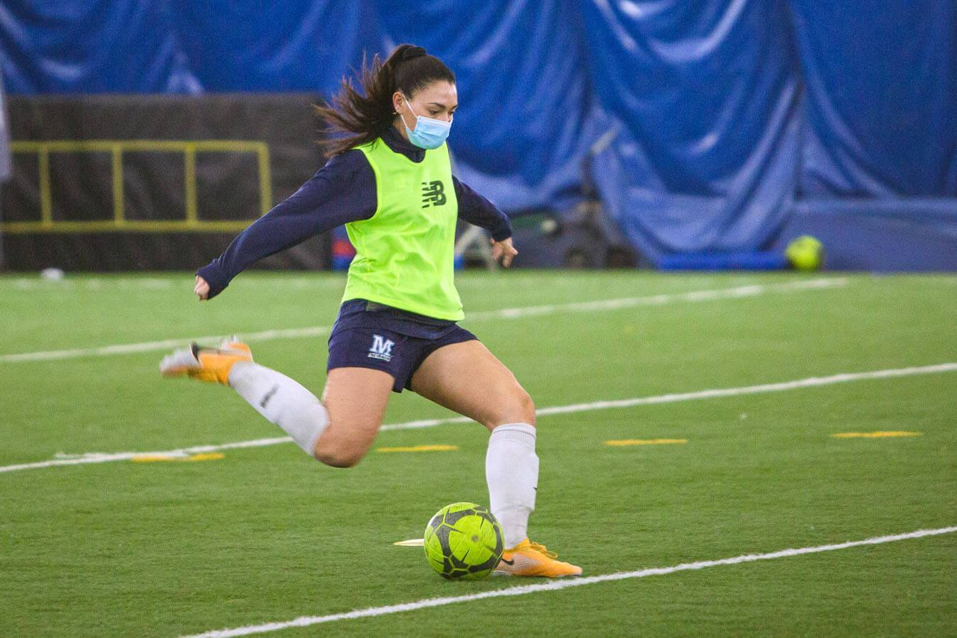 Women's soccer team  practices in Mahaney Dome.