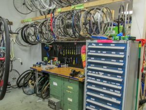 spare wheels and other parts at a bike repair shop