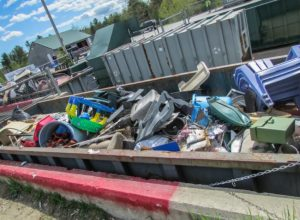 dumpster full of thrown away objects