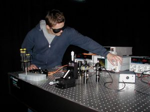 Photo of graduate student testing a photodiode