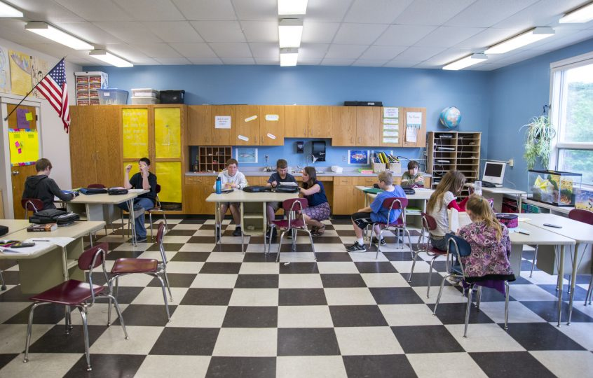 wide shot of a small middle school classroom with students