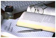 Image of common office items representing academic work