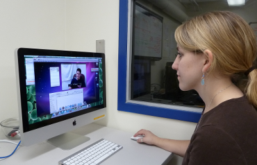 Graduate student conducting research in a Psychology lab