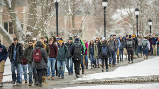 Photo of students walking to class in the snow