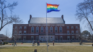 Photo of Rainbow flag in front of Fogler Library