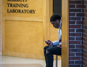 Photo of a student waiting for class to begin