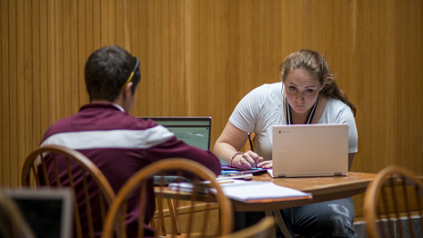 Color photo of two students studying