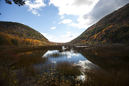 Colored image of a small mountain pond in the fall