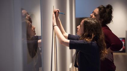 UM Colleagues curating art exhibit