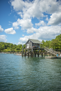 Colored image of a fishing shack on the coast of Maine