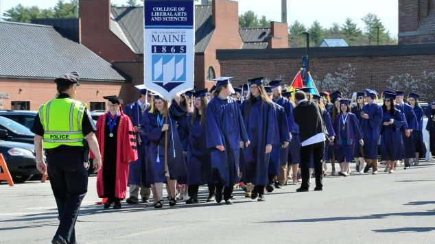 Image of CLAS graduating class walking