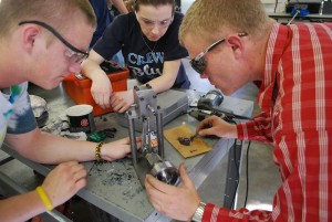 Mechanical Engineering Technology students working on a project together.