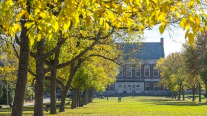 Fogler Library and trees with fall foliage