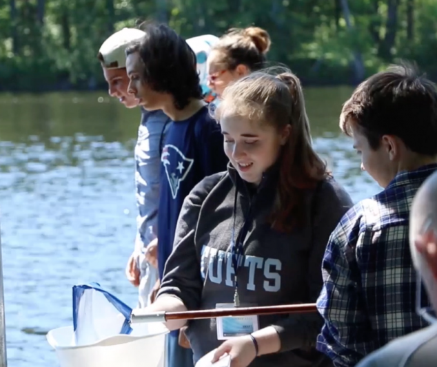 group of students sample macroinvertebrates in Penobscot River