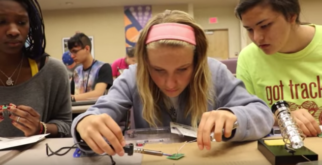three female SMART students work together to create a sensor