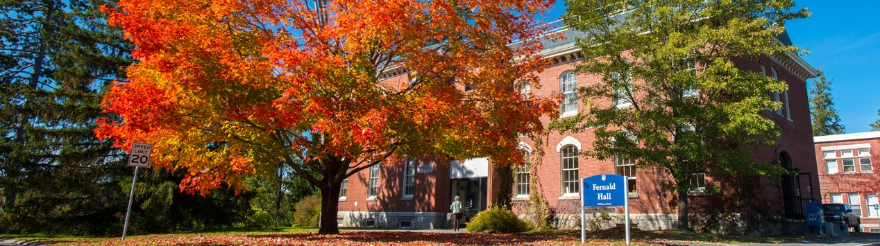 Header image of Fernald Hall with fall foliage