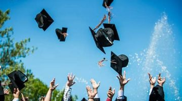 graduation caps in the sky