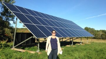 Dr. Sharon Klein standing by solar panel