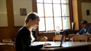 Picture of student in library