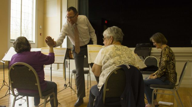 phil edelman teaches a music class for old adults