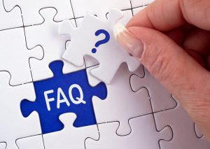 "Puzzle piece with a question on it being put in the last open spot on a puzzle with ""FAQ"" in it"