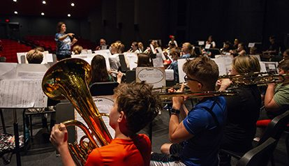 kids in orchestra at music camp