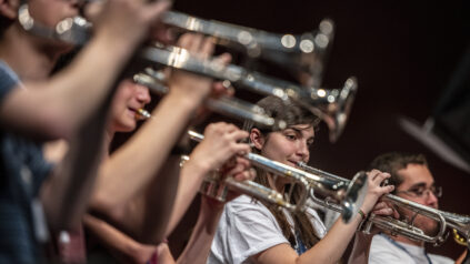 A group of students playing brass instruments at a music summer camp in Orono Maine