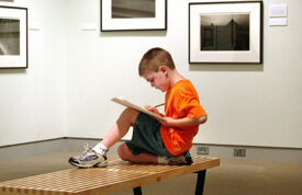 Young boy sketching at an art summer camp in Bangor Maine