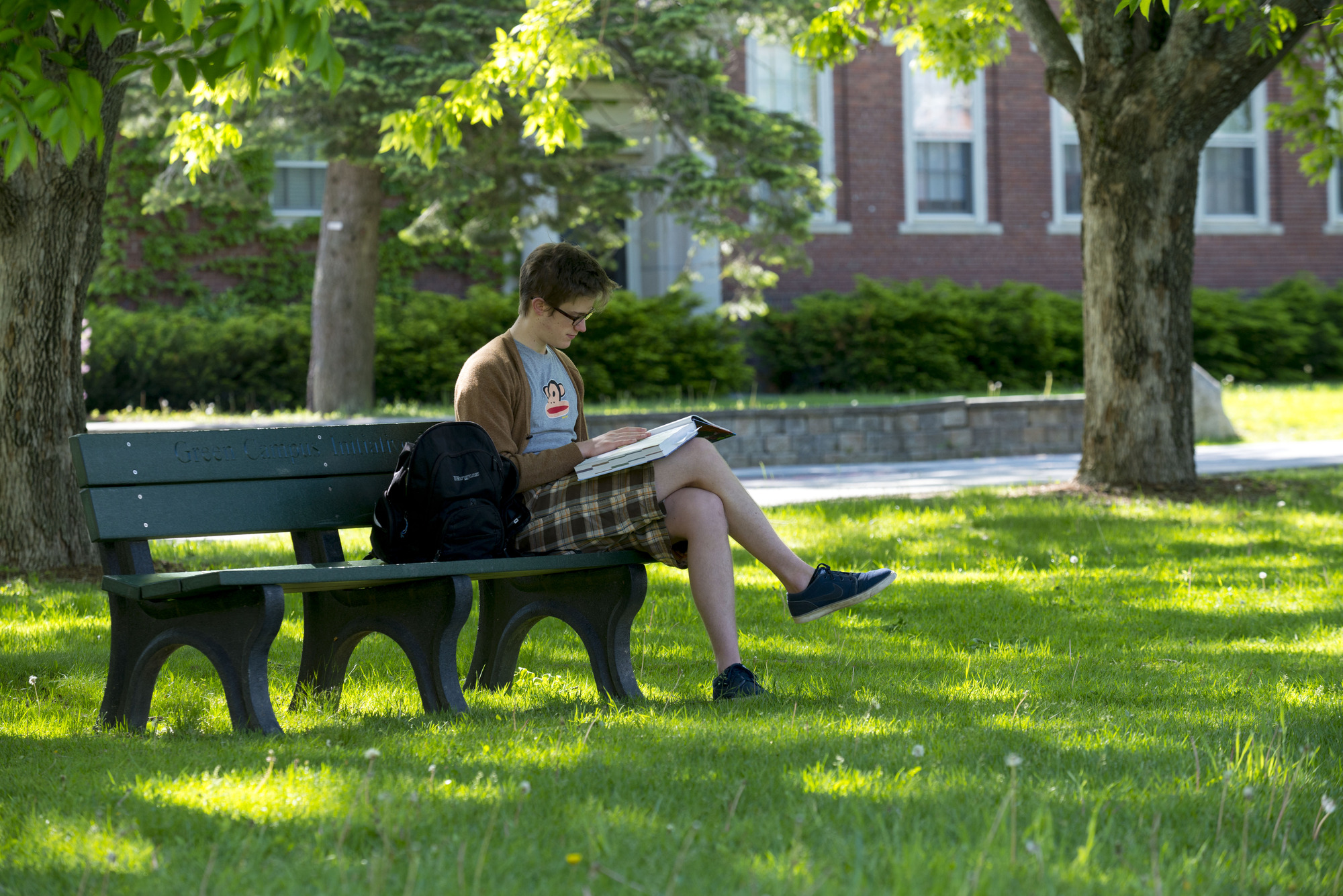 student studying on bench