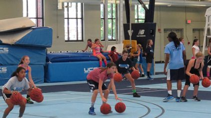 girls playing basketball at sports camp