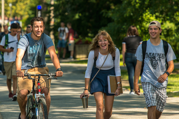 students walking and biking on campus