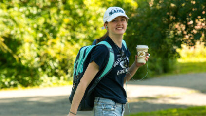 student walking and smiling