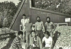 Historical image of students installing the rock bed for passive solar heat storage