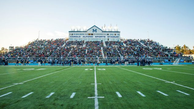 The bleachers are filled for a football game at the Alfond Stadium