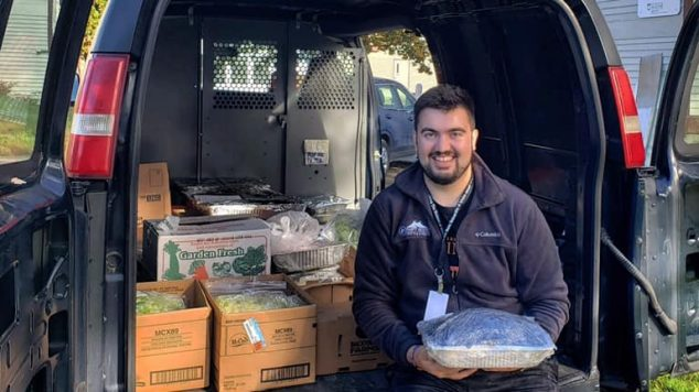 Student collecting food for UMaine food recovery program