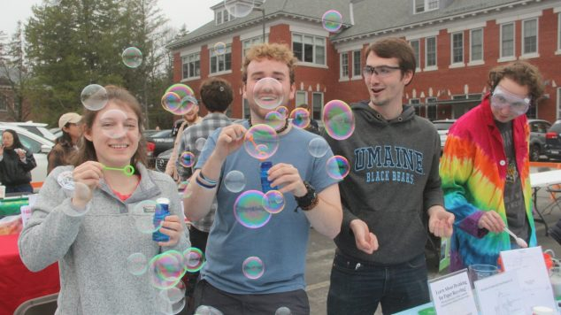 Students at Spring Fest blowing bubbles.