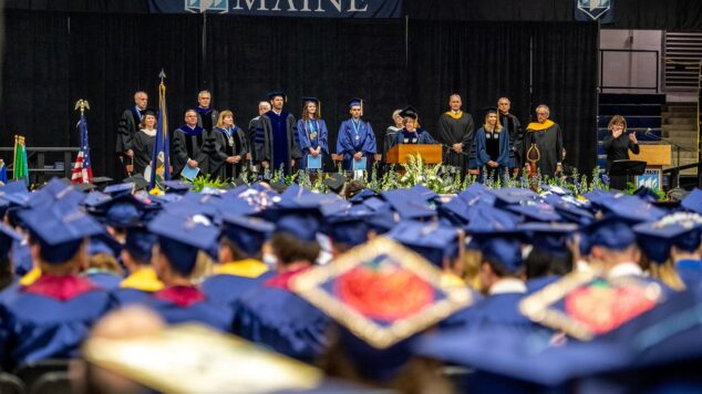 Banner for Governance section showing President Ferrini-Mundy speaking at graduation.