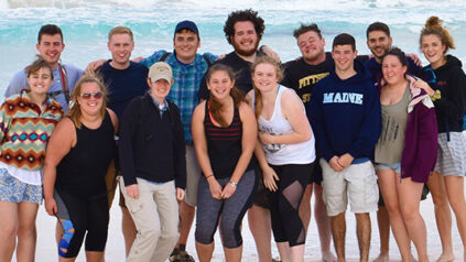 students on beach in the Bahamas