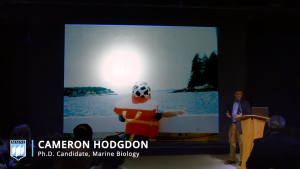 Cameron Hodgdon performs his winning Three Minute Thesis on March 25 at the IMRC.