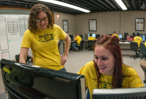 Picture of Lab members Kendra Bird and Emily Blackwood working on a gis project