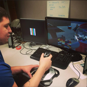 Scott Richards working on his virtual toy box simulation where the objective is to protect the toy box from invading toys