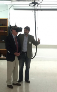 Senator Angus King and VEMI Lab Director of Operations Dr. Richard Corey using an HMD to explore virtual environments created here at VEMI