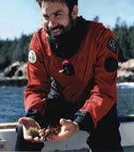 Rick Wahle showcasing marine invertebrates.
