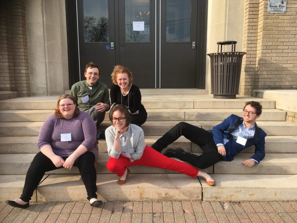 Peer-Tutors reveling in glory after a successful conference presentation at NEWCA