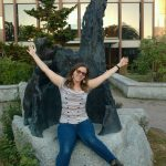 Meija in front of the bear statue