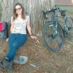 Meija in front of a tree
