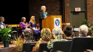 woman giving speech at podium