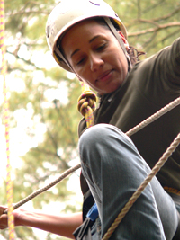 woman attempting the challenge course